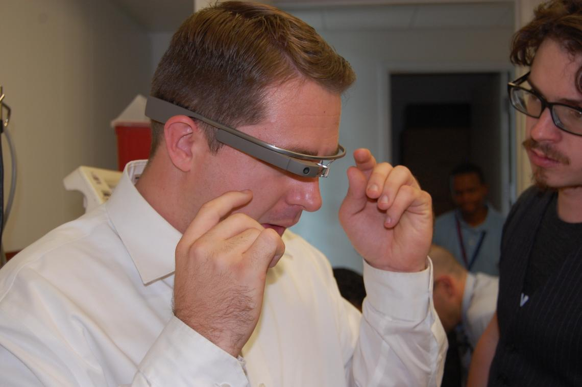 Fourth-year UA College of Medicine – Phoenix students Christian Dameff  and Jeff Tully  demonstrate the Google Glass device.