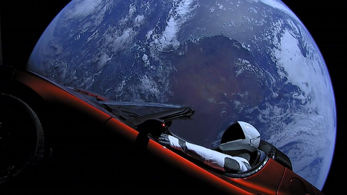 The Tesla Roadster and its mannequin passenger, Starman. This image was captured by cameras onboard the vehicle.