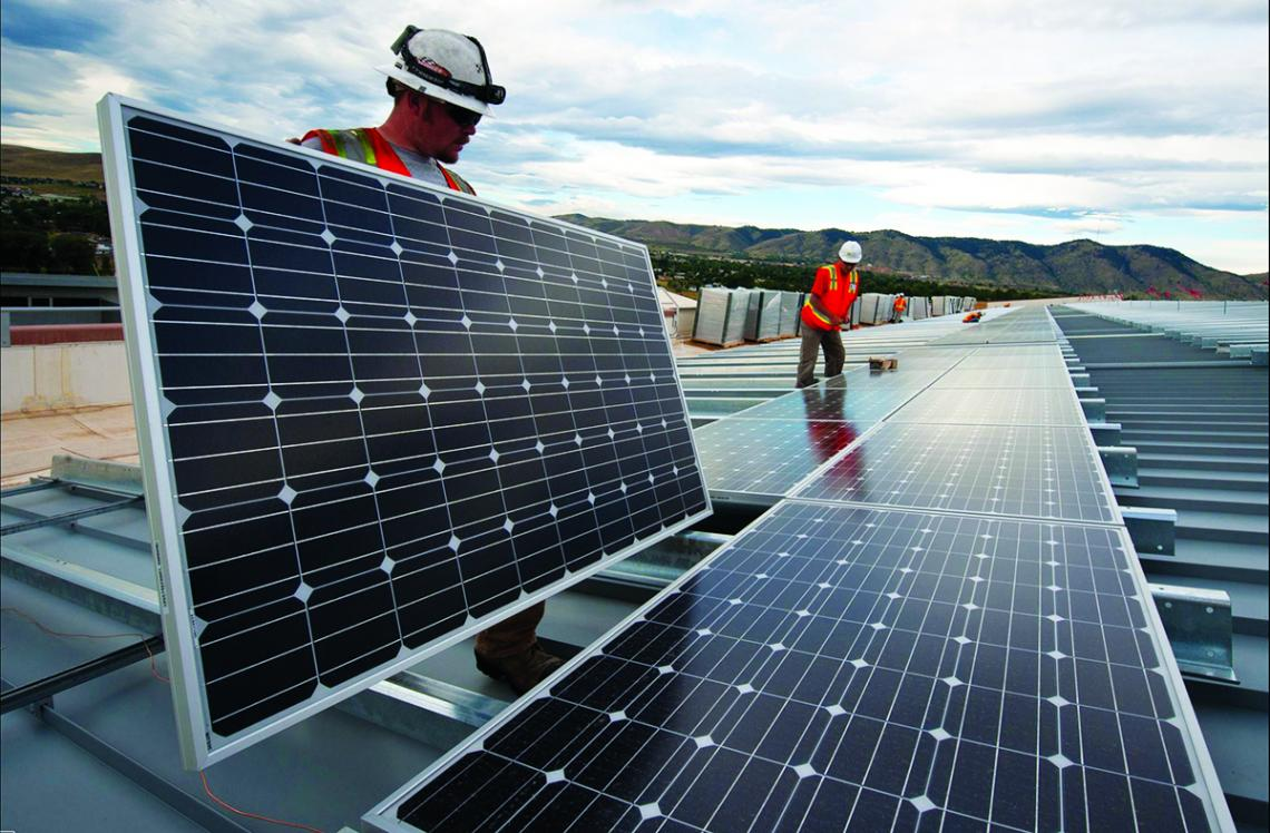 Workers install solar panels to capture renewable energy.
