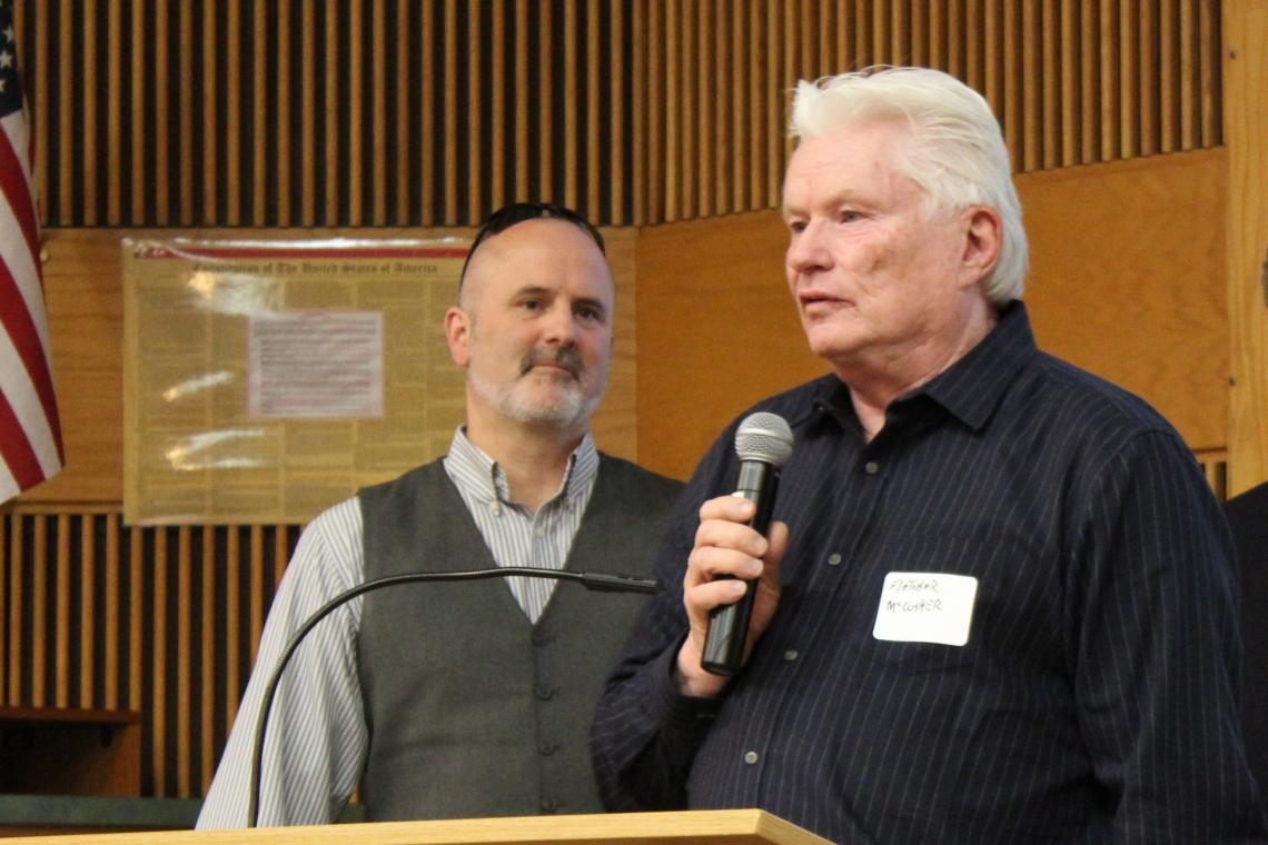 Fletcher McCusker  speaks at the 2018 Tech Launch Arizona I-Squared Awards, where he was honored with the award for Ecosystem Impact. TLA Assistant Vice President Doug Hockstad looks on.