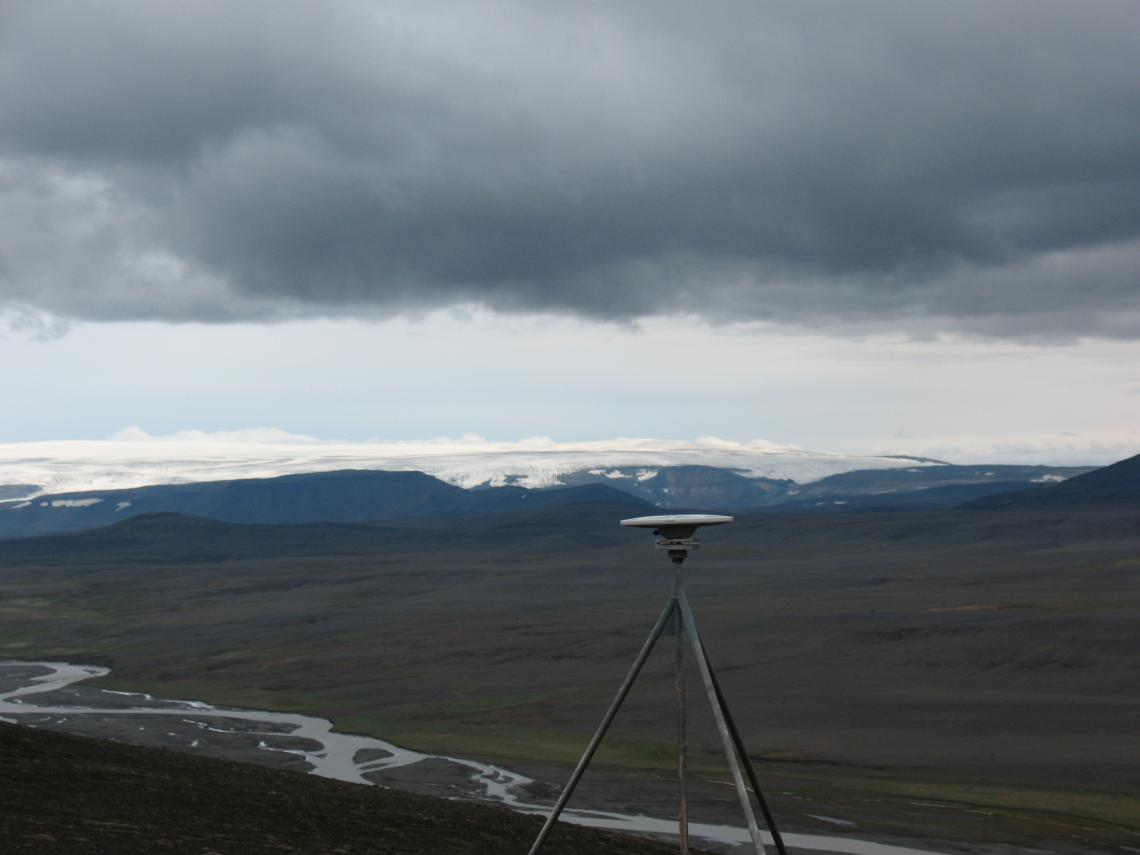 This global positioning satellite receiver is part of Iceland's network of 62 such receivers that geoscientists are using to detect movements of the Icelandic crust that are as small as one millimeter per year. Langjokull glacier is in the background.