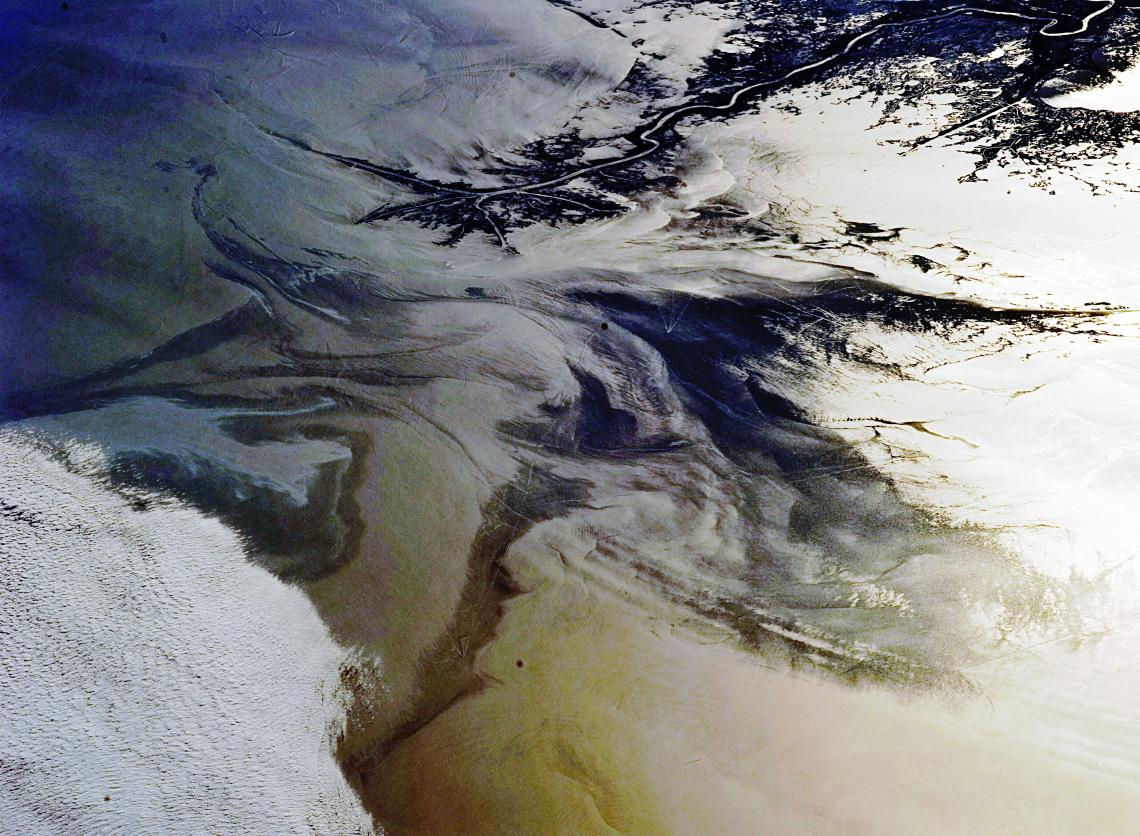 A view of the Gulf of Mexico oil spill from the International Space Station. UA professor Brian Mayer is studying the long-term social and environmental effects of the spill on residents of the Gulf Coast.