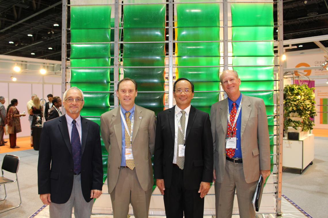Standing in front of the Accordion photobioreactor developed at CALS and patented by the Arizona Board of Regents are : Gene Giacomelli, director of the Controlled Environment Agriculture Center and professor of  agricultural and biosystems engineering; S