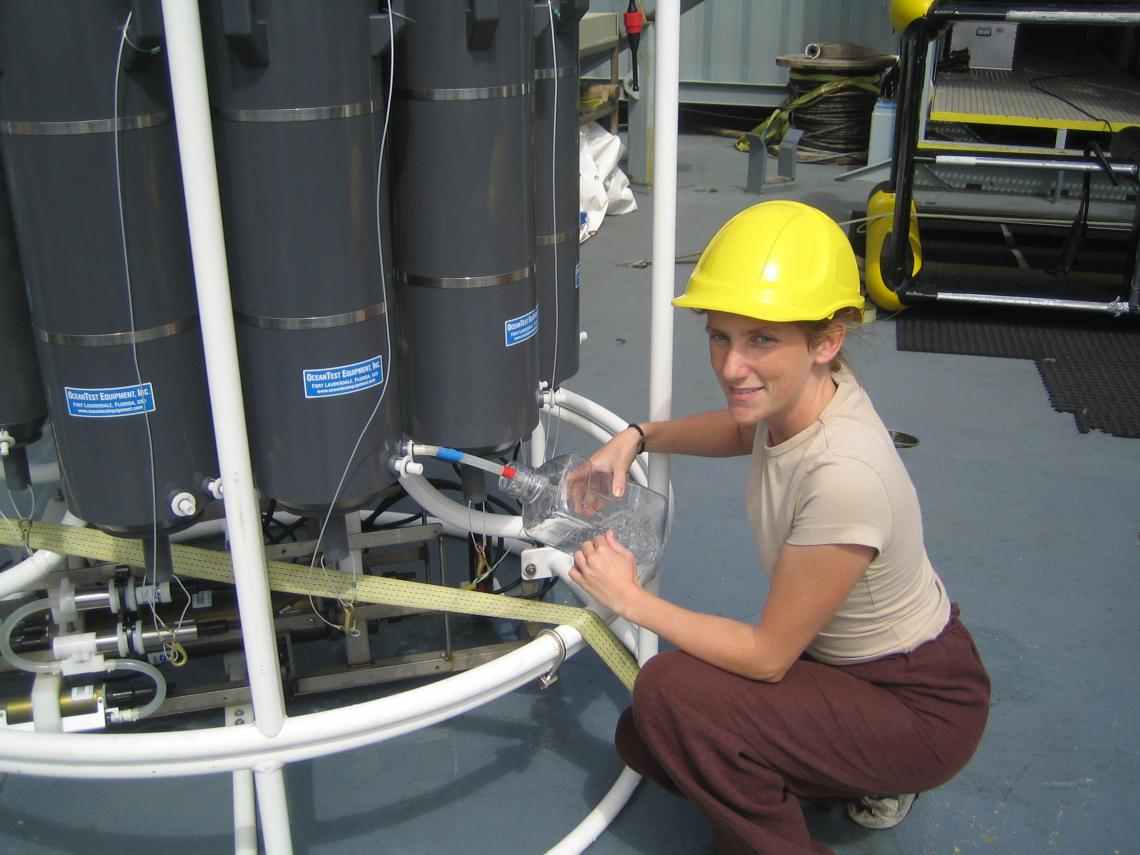 Karin Holmfeldt, the study's first author, aboard a research vessel sampling viruses in the Atlantic Ocean.
