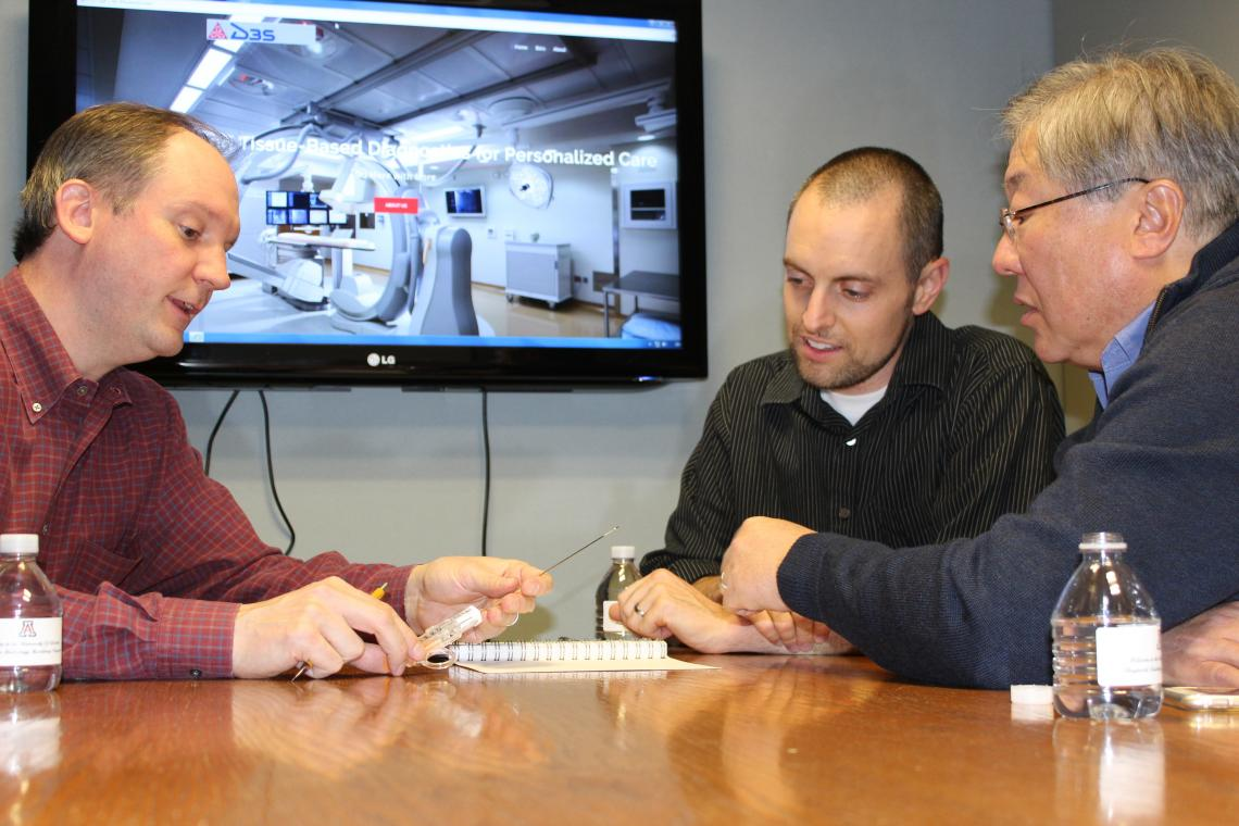 Co-inventors Dr. Charles Hennemeyer  and Dr. Michael Larson  discuss design ideas with D3S CEO Nick Lim.