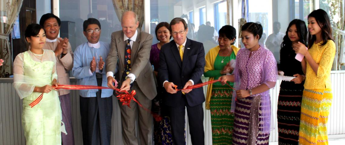 The UA's Kevin Fitzsimmons and James Goggin of USAID open the UA office that will administer the sustainable seafood industry development project. The office is located in the Myanmar Fisheries Federation building in Yangon, Myanmar.