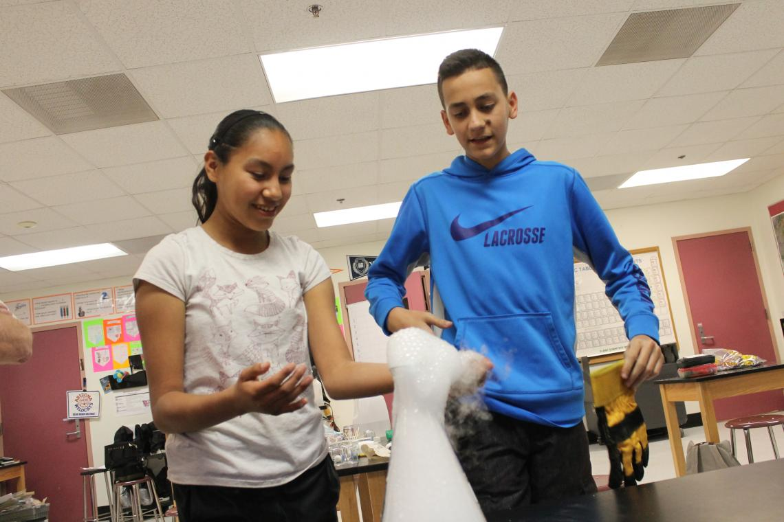 Baboquivari Middle School students Rosalina Mendez, 13, and Brightstar Benson, 13, participate in UA biochemist John Jewett's after-school program, funded by the NSF.