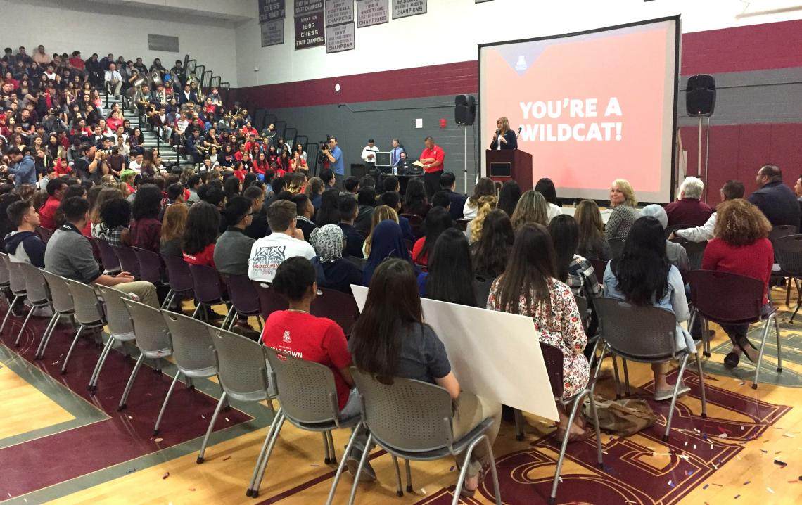 Kasey Urquidez, the UA's vice president for Enrollment Management and Student Affairs Advancement, informs a group of Desert View High School seniors that they have been accepted to the UA.