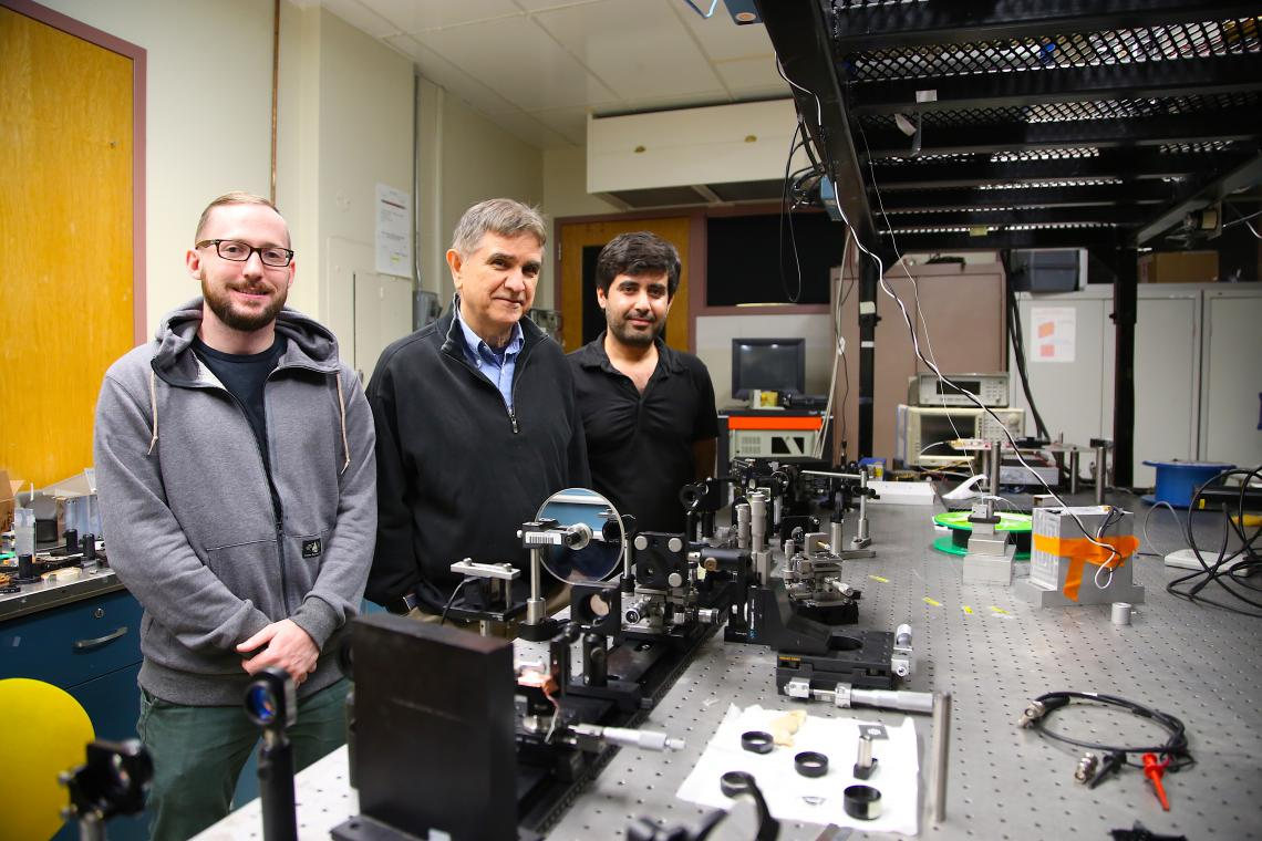 From left: Joshua Olson, a graduate student studying ultrafast fiber lasers; Nasser Peyghambarian; and Veyesi Demir, a postdoctoral researcher working on optical computing.