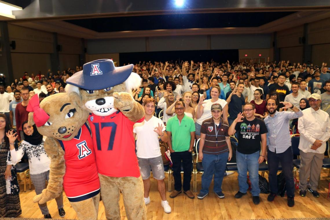 UA international students receive a Wilma-and-Wilbur welcome at the Student Union Memorial Center's Grand Ballroom.