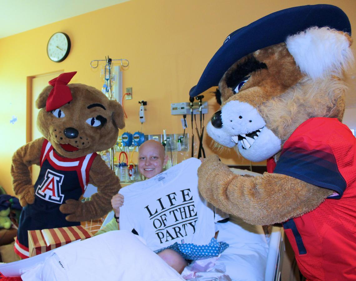 """Friends and family had to keep the surprise UA acceptance announcement a secret from Kelsey Luria, waiting for a time it for when she was feeling well enough. Luria was dressed for the occasion, however, as her hospital floor had instituted a """"Bear Down T"""