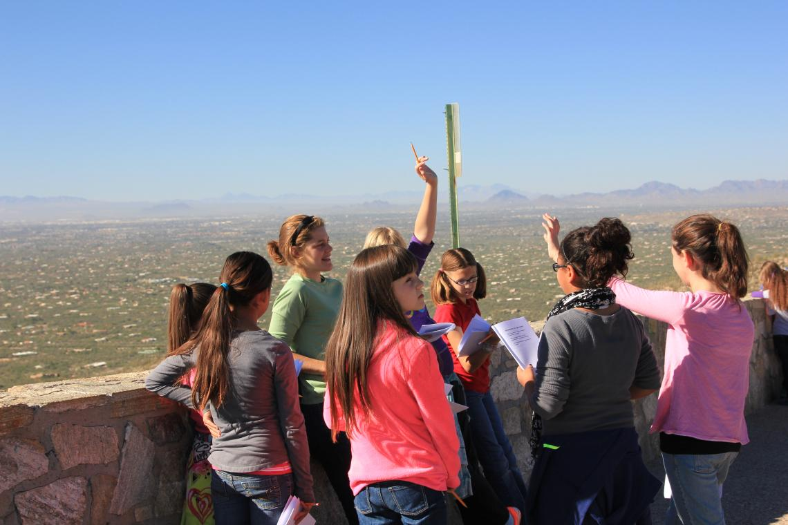 Moira Hough , a doctoral candidate in the department of ecology and evolutionary biology, guides students through activities as they make their way up Mt. Lemmon from the city of Tucson, measuring elevation and temperature along the way.