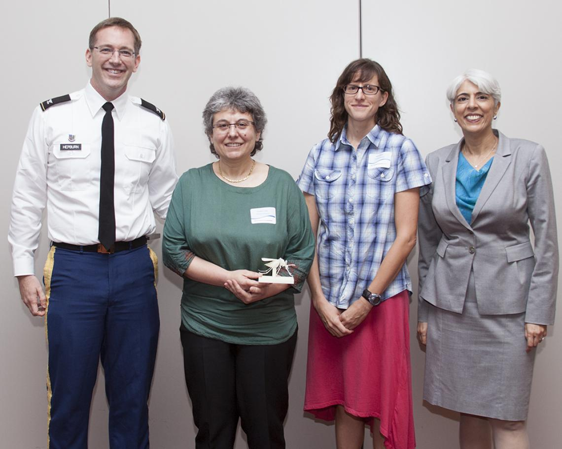 Col. Matt Hepburn , the DARPA program manager for the CHIKV Challenge, with UA researchers Joceline Lega and Heidi Brown and also Arati Prabhakar, director of the Defense Advanced Research Projects Agency.