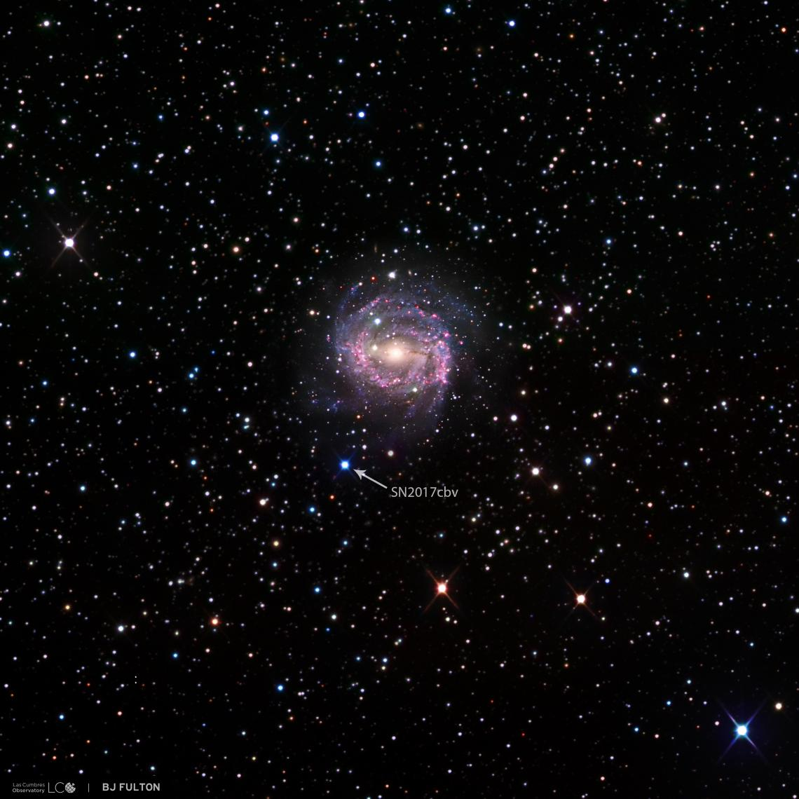"""Bright blue dot: Supernovae such as SN 2017cbv appear as """"stars that weren't there before,"""" which is why multiple images taken over time are necessary to reveal their true identity. SN 2017cbv lies in the outskirts of a spiral galaxy called NGC 5643 that"""