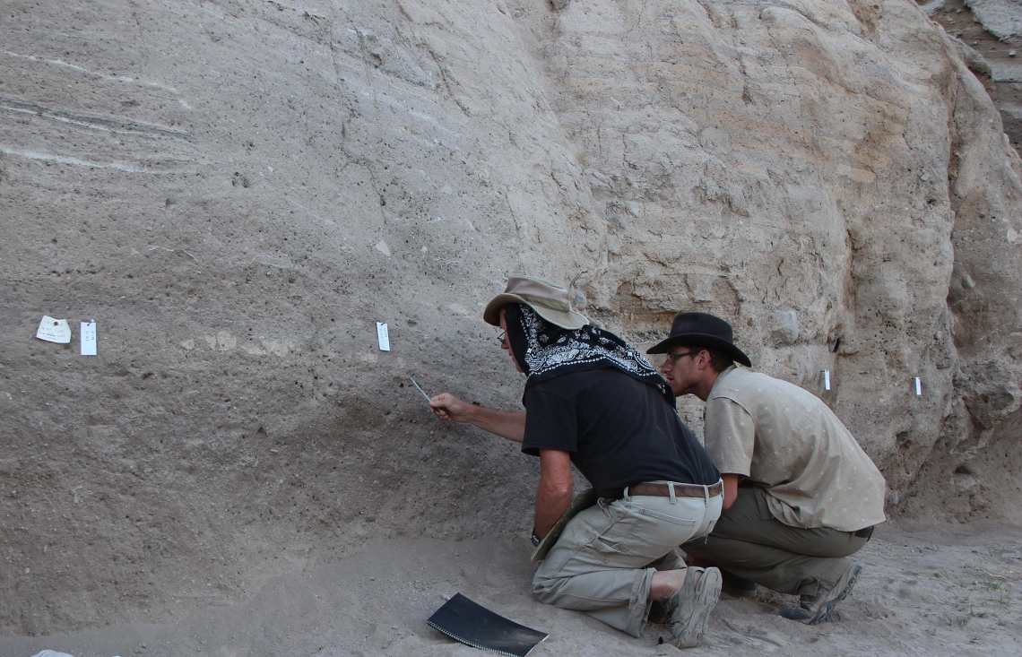 From left: Study authors Jay Quade and Jordan Abell collect samples at the site of an ancient Turkish settlement where salts left behind by animal and human urine give clues about the development of livestock herding.