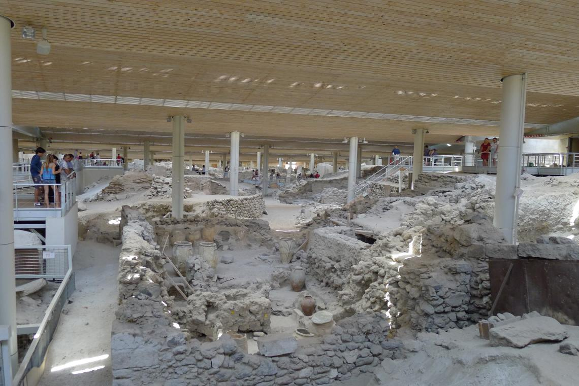 Akrotiri is the Minoan town on Santorini that was damaged by earthquakes building up to the eruption and then buried under ash once Thera erupted.The whole town site has a modern roof structure over it to protect the fragile site from the elements.