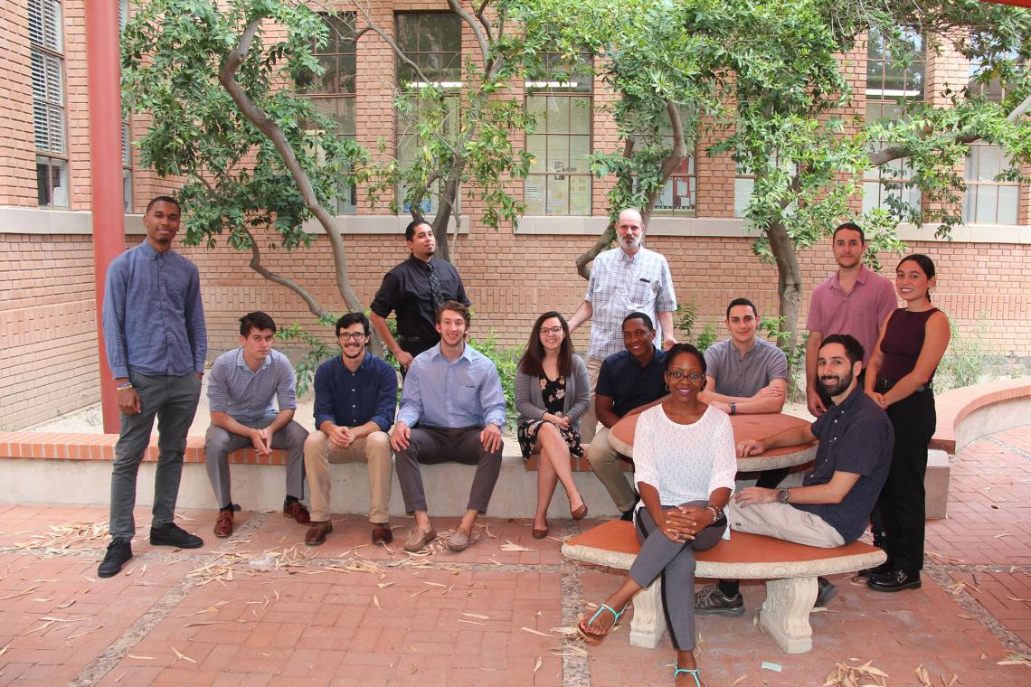 The current Bridge to Doctorate cohort students, with UA faculty and staff. Back row, left to right: Terrance DeLisser, Zachary Binger, Joseph Moya, Samuel Cabral, Nathan Reiland, Erica Vanover, UA professor Jim Field, Pierce Longmire, Joseph Agosttini, J