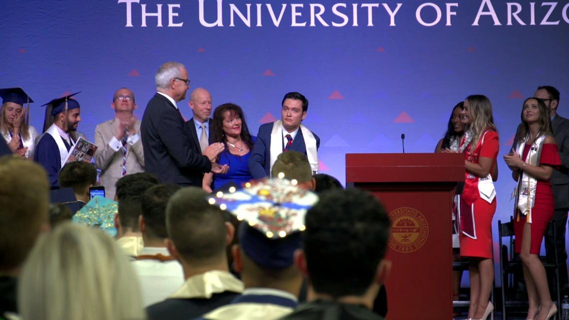 After spending most of his life in a wheelchair, Jeffrey Bristol  was able to stand to receive his UA diploma.