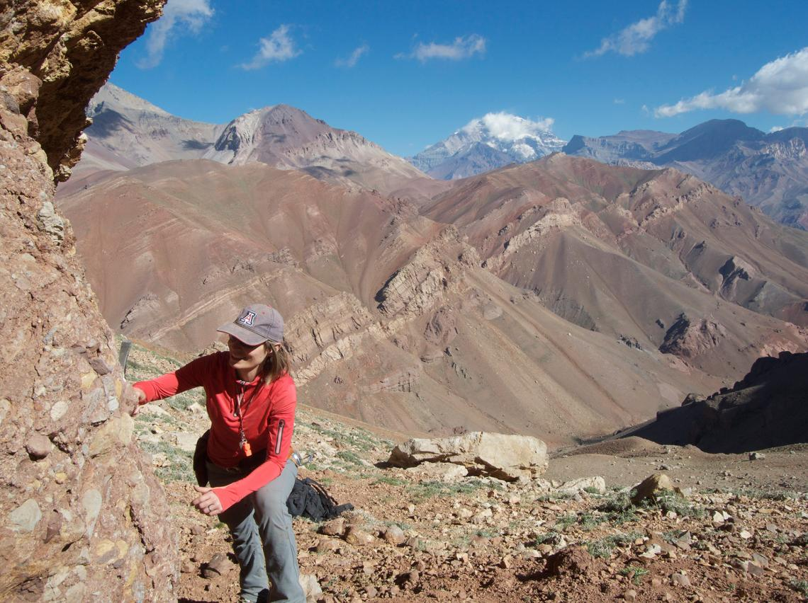 Barbara Carrapa takes rock samples at 14,000 feet  on Cerro Penitentes in the Cordillera Central of Argentina.