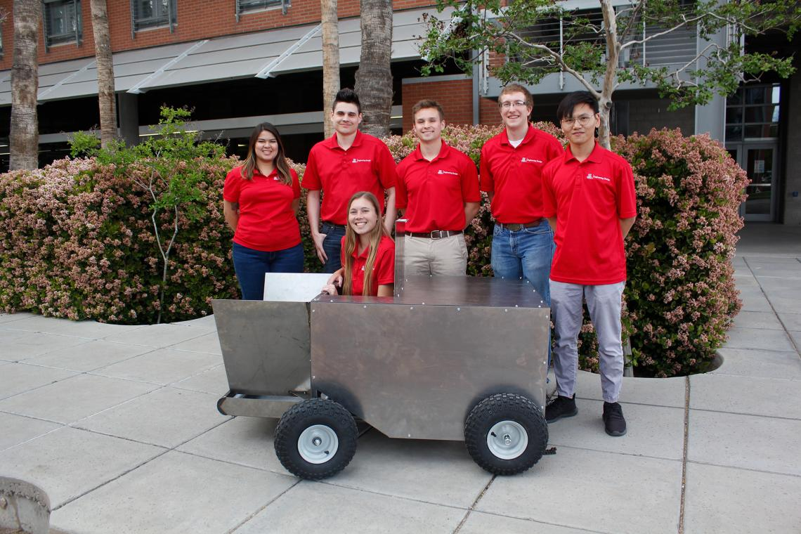 Savannah Brown, Sean Rowlands, Cooper Wynn, Devin Murphy and Weicheng Li, with Hannah Whetzel acting as a stand-in for a grasshopper in the grasshopper catcher they designed for Engineering Design Day.