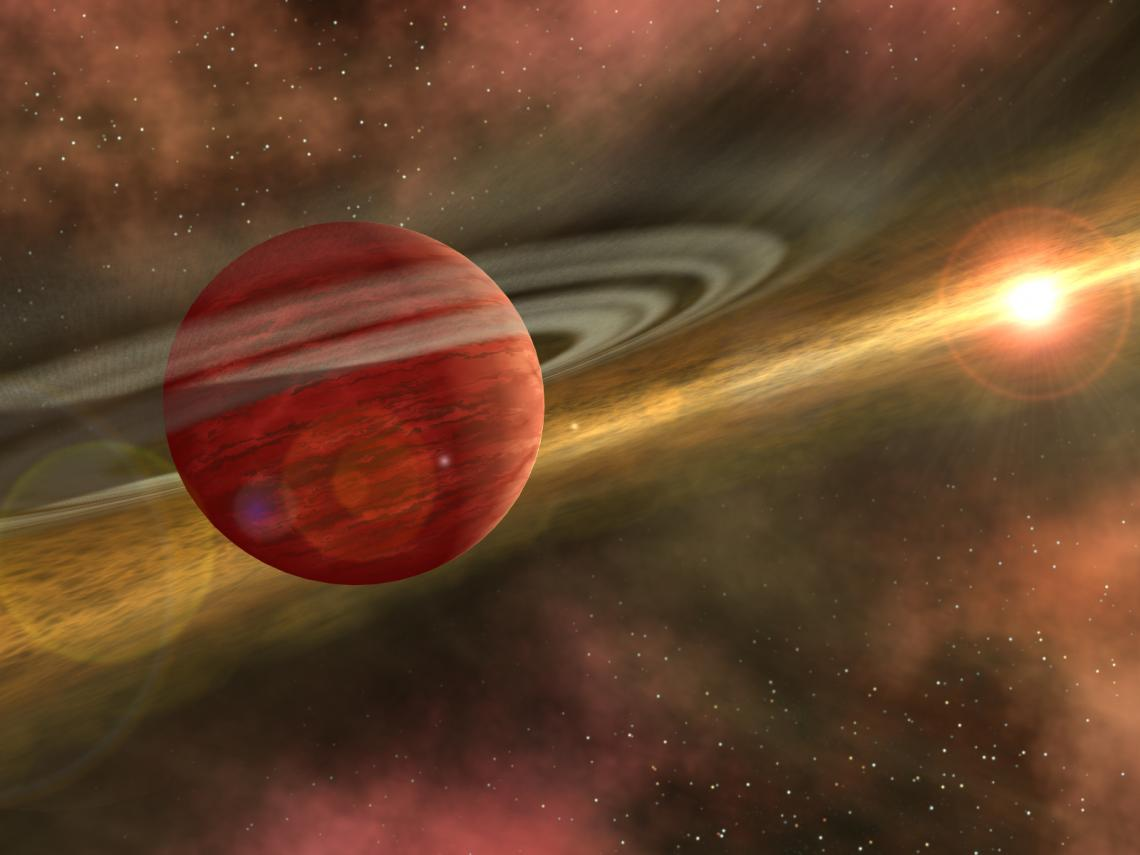 This is an artist's conception of a young planet in a distant orbit around its host star. The star still harbors a debris disk, remnant material from star and planet formation, interior to the planet's orbit .
