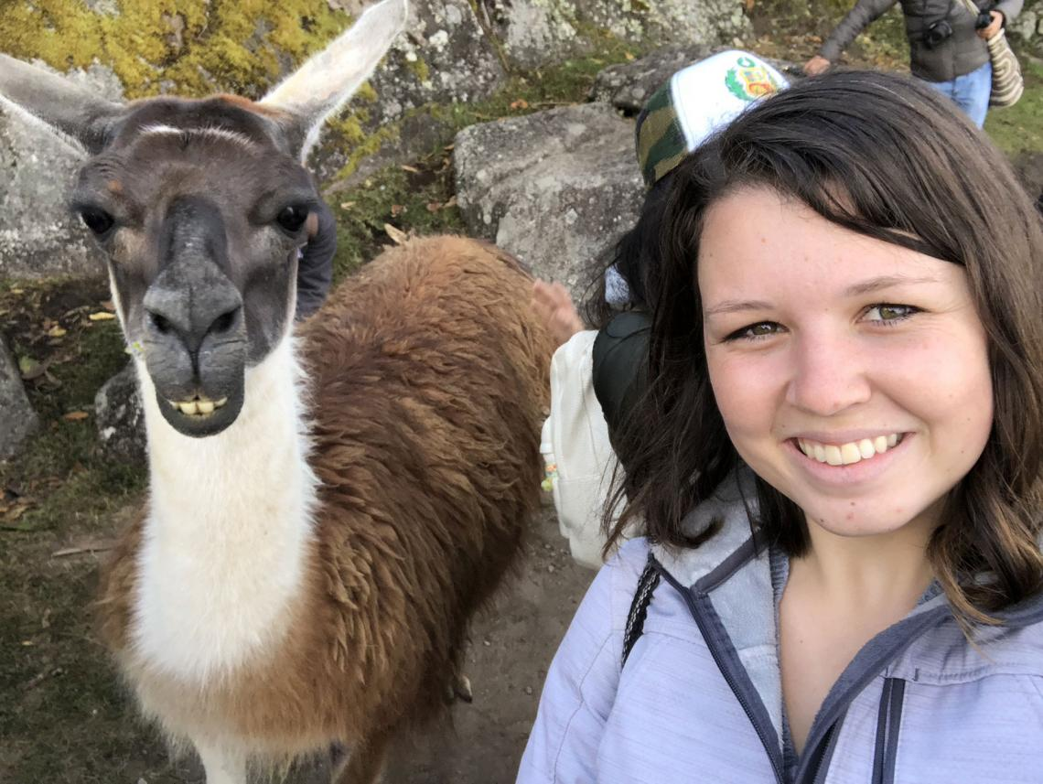 Gracie Krigbaum with a llama in Machu Picchu during a trip to Peru.