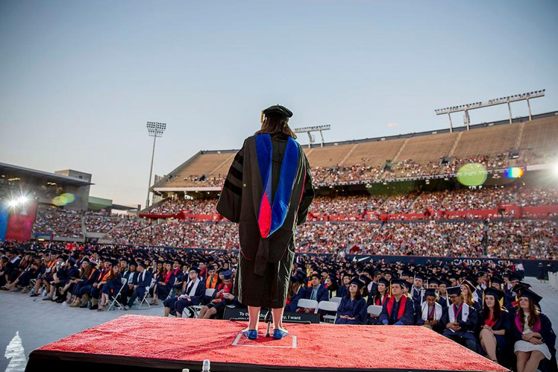 Professor Melissa Fitch addresses the crowd during the pre-Commencement show last year. Thousands of UA students will receive degrees during the 2017 ceremony, to be held in Arizona Stadium on May 12.