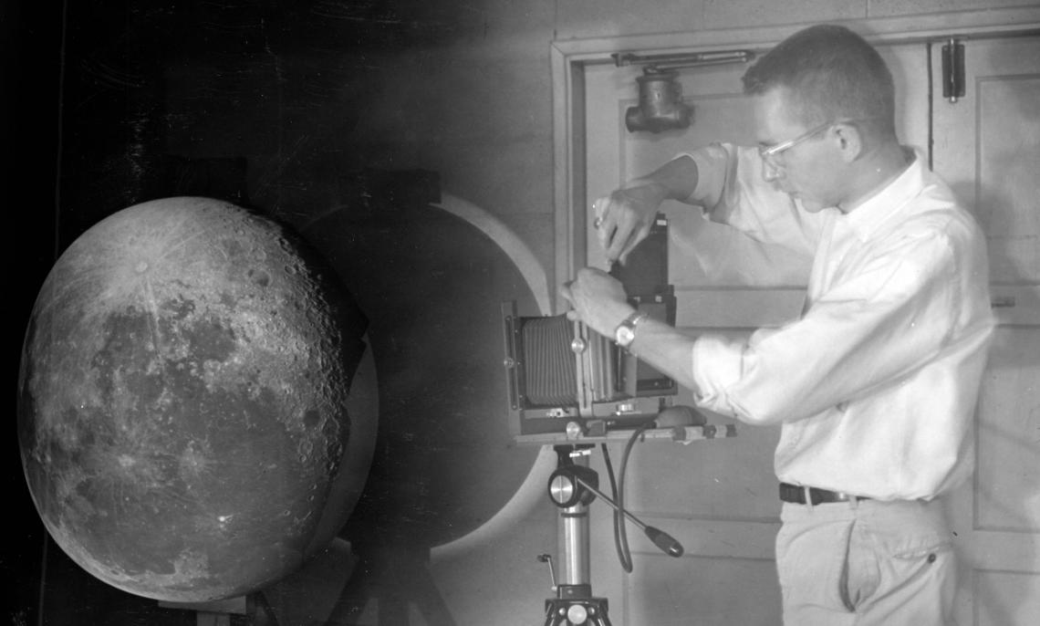 William Hartmann projecting photographic plates of the moon onto a white globe to create the Rectified Lunar Atlas.