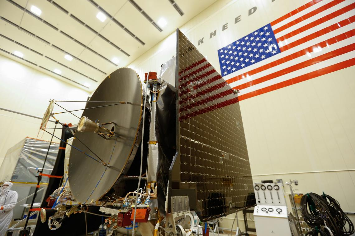 The high gain antenna and solar arrays are installed on the OSIRIS-REx spacecraft before moving to environmental testing.
