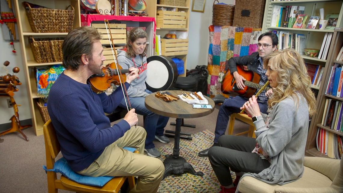 Members of Tíolacadh, the UA's traditional Irish music ensemble, learn tunes from each other by ear.