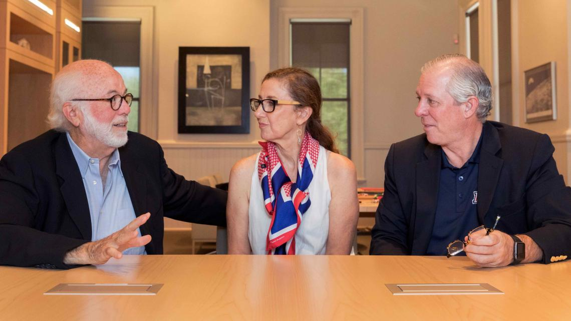 UA President Robert C. Robbins  meets with Pulitzer Prize-winning photographer David Hume Kennerly  and his wife, Rebecca Soladay Kennerly.