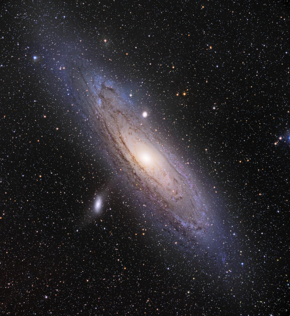Our Milky Way's largest neighbor, the Andromeda Galaxy, spans about 220,000 light-years across. Two of its dwarf satellite galaxies, Messier 110  and Messier 32 , are visible as bright white spots in this image taken by UA astrophotographer Adam Block.