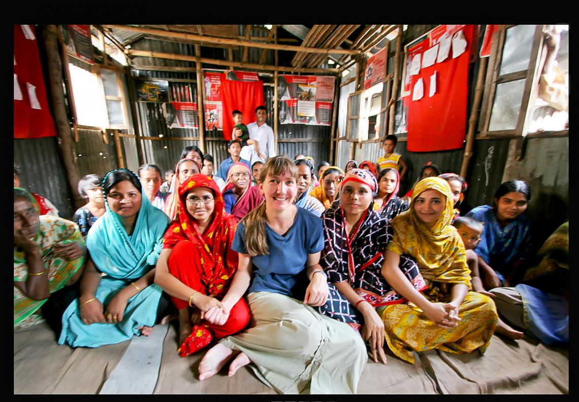 Marla Smith-Nilson, center, meets with a community group in a slum of Dhaka, Bangladesh's capital city, where millions lack access to clean water.