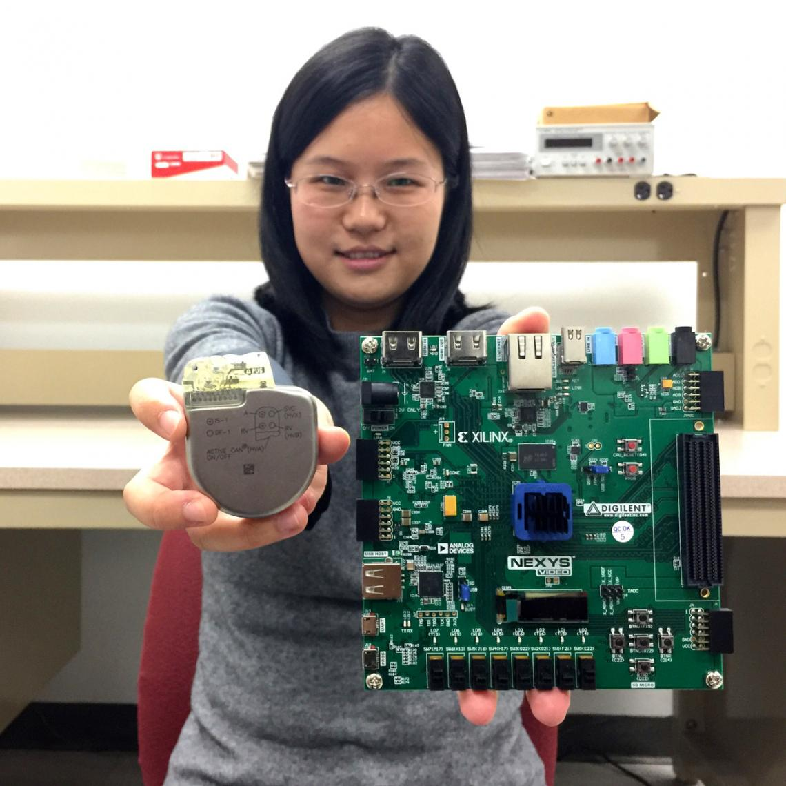 UA doctoral student Sixing Lu is helping associate professor Roman Lysecky develop technology on a prototype network-connected pacemaker  to detect hacking of a real pacemaker .