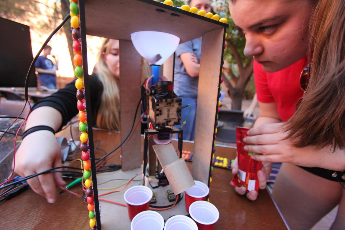 A team confirms all systems are go on its Skittle-sorting machine before the undergraduate design competition co-hosted by the UA Department of Biomedical Engineering and School of Information.