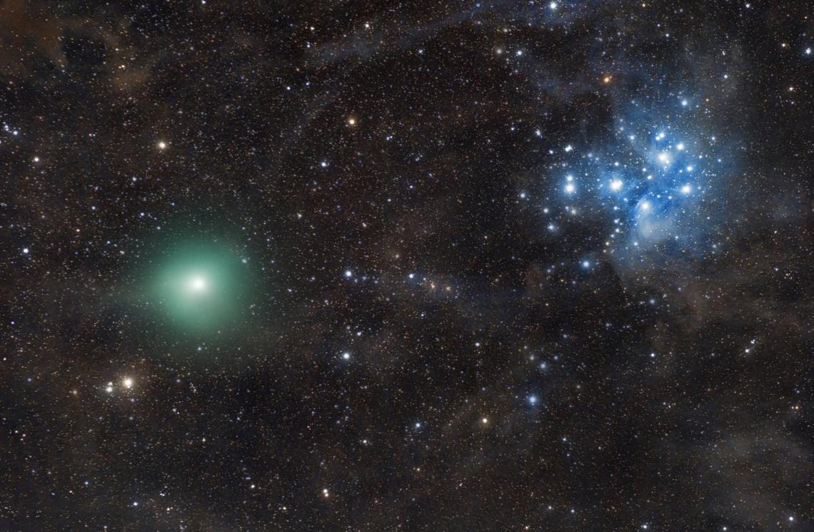 Comet P46/Wirtanen  is seen here crossing a dark, moonless night sky on Dec. 17, with the Pleiades looming in the background.