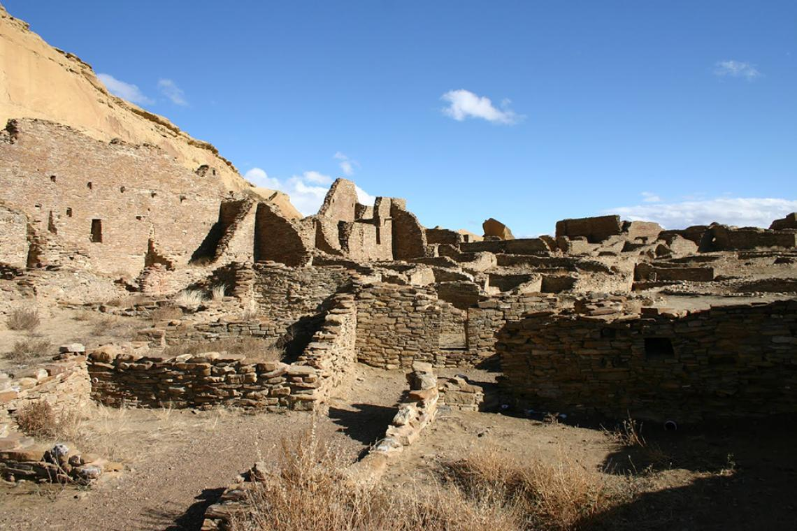 The north wall and room block of Pueblo Bonito, the largest of the great houses in Chaco Canyon. Pueblo Bonito is considered widely as the center of the Chaco world.