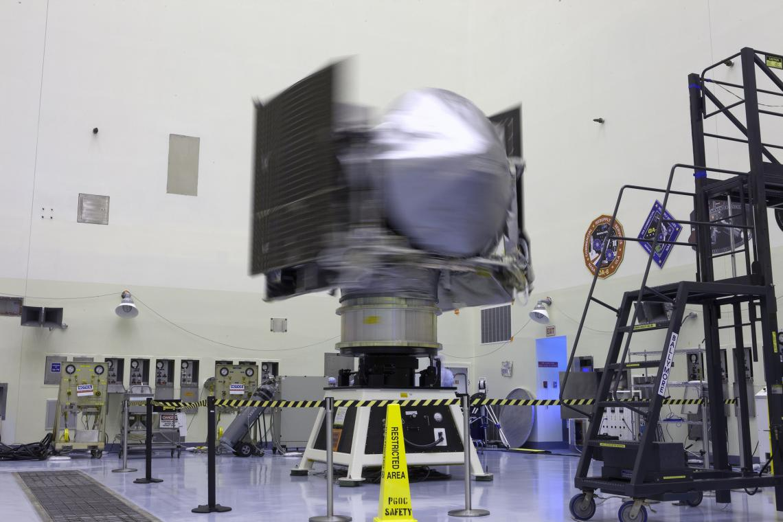 NASA's OSIRIS-REx spacecraft rotates on a spin table during a weight and center of gravity test inside the Payload Hazardous Servicing Facility at Kennedy Space Center in Florida. The spacecraft is being prepared for its scheduled launch on Sept. 8.