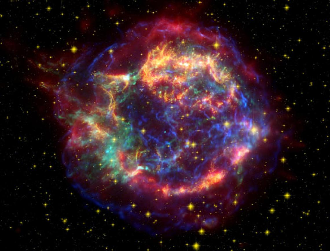A small, bright neutron star can be seen as a tiny blue dot at the center of this image.