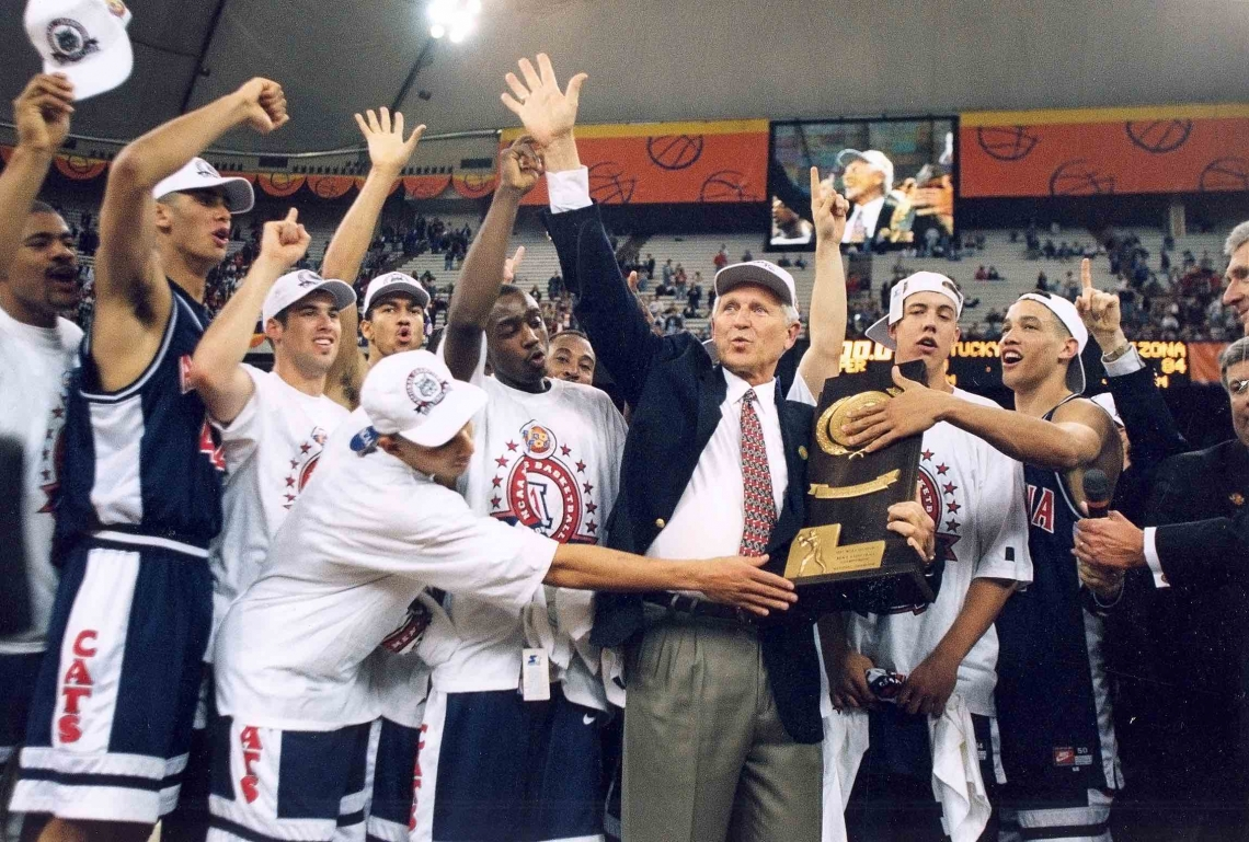 Lute Olson and the Arizona Wildcats celebrate winning the 1997 National Men's Basketball Championship.