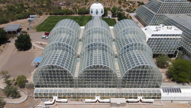 The Landscape Evolution Observatory is housed under the steel-and-glass architecture of UArizona's Biosphere 2.
