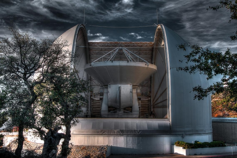 The 12-meter telescope of the Arizona Radio Observatory in its dome at Kitt Peak.