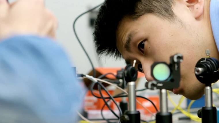 researcher working on quantum nanophotonic system design