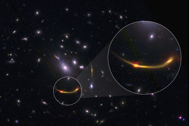 Gravitationally lensed galaxy cluster showing distribution of cold hydrogen gas