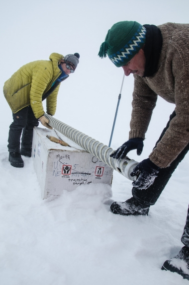 Researchers handling an ice core