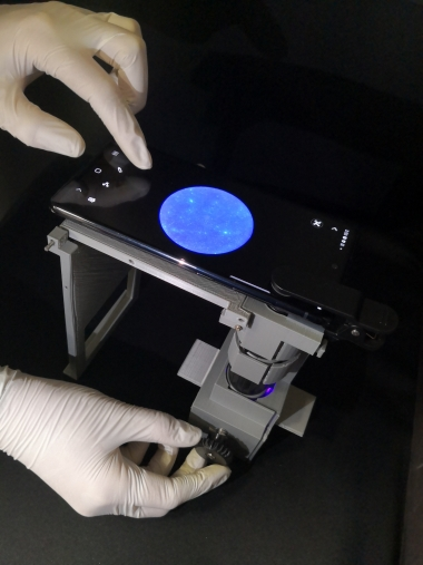 hands using a smartphone microscope