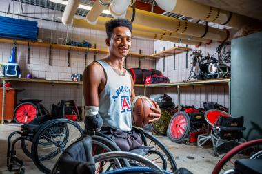 Josh Brewer in the UA Men's Wheelchair Basketball Team's equipment room at the Student Recreation Center.