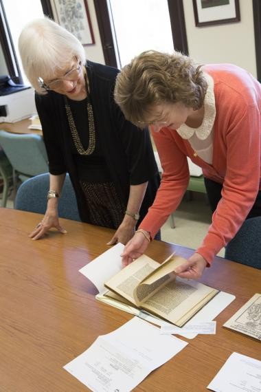 Susan Karant-Nunn and Ute Lotz-Heumann, professors in the UA Division for Late Medieval and Reformation Studies, examine the two new acquisitions to University Libraries' Special Collections purchased by the Laura and Arch Brown Library Endowment.