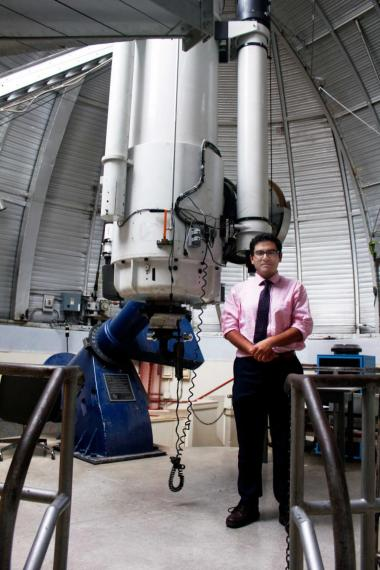 Electrical and computer engineering student Arash Roshanineshat spends many of his nights looking up at the stars at the UA's Steward Observatory.