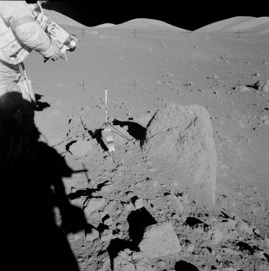 The ANGSA samples Jessica Barnes is studying, including Apollo 17 sample 71036, were chipped from this boulder. Astronaut Jack Schmitt is seen on the left.